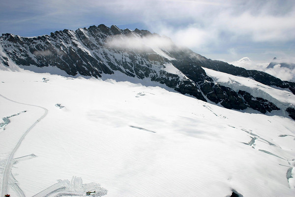 From the Sphinx Observatory, at the Jungfraujoch - across the upper section of the snow-covered Aletsch Glacier - to the western face of the Trugberg, partially covered by drifting cloud - and the peak of the Finsteraarhorn, rising to 14,022 ft. (4,274 m), the highest point in the Bernese Alps, mostly covered by clouds along the distal horizon - canton of Valais