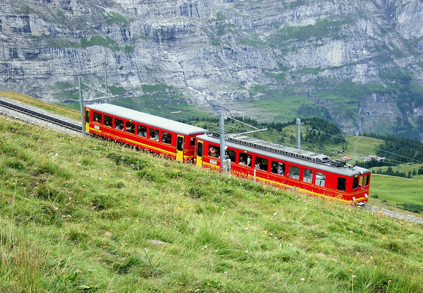 Jungfraubahn (Virgin or Maiden Train) - construction for this rack railway started in 1896, and opened for service in 1912 - the trains destination is the Jungfraujoch (the yoke or saddle between the Eiger and the Mönch) - the highest railway station in Europe, at 11,320 ft. (3,450 m) - canton of Bern