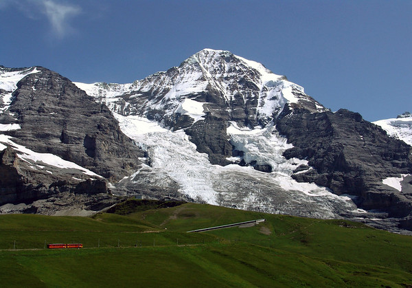 Jungfraubahn - railway has been plying its way through a 4 mi. (7 km) long tunnel to the top of the Jungfraujoch since 1912 - here beyond the Eiger Glacier, up to the Mönch, peaking at 13,474 ft. (4,107 m) and the Sphinx Observatory at the Jungfraujoch, rising to 11,782 ft. (3,571 m) along the right horizon - in the Bernese Alps - canton of Bern