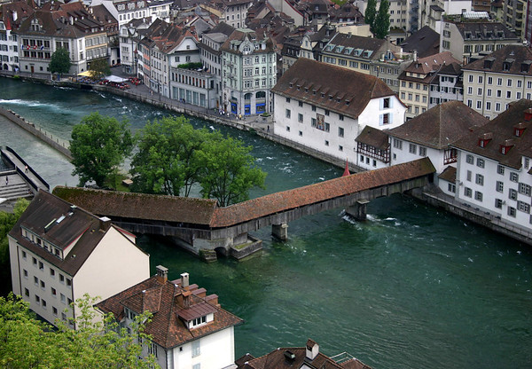 From the Mannliturm (Mannli Tower) - down to the Spreuerbrücke (Mill Bridge) that angles across the Reuss River, constructed in 1568 - Lucerne