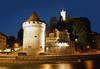 """Across the Reuss River to the Nolliturm and the Luegislandturm - two of the 9 remaining towers built along the Museggmauer (Musegg Wall), the old fortress wall built from 1370-1442, around the Alstadt """"old city"""" - Lucerne"""