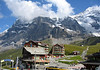 From the alpine village of Kleine Scheidegg - up to the southern slopes of the Eiger (with the summit engulfed with cumulus clouds) - and beyond the partially shaded Eiger Glacier, to the Mönch - canton of Bern