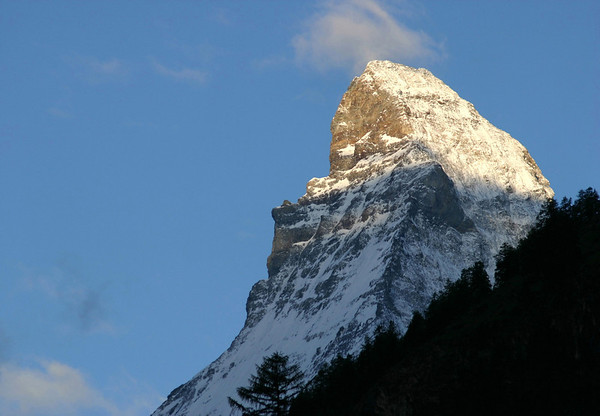 Day's first sunlight upon the summit of the Matterhorn - northeast view