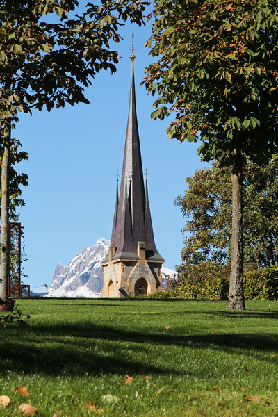 Church in front of snow-covered mountain in the resort of Bad Ragaz, Switzerland