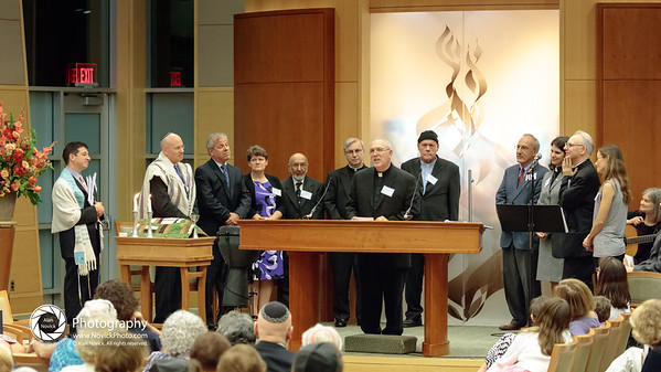 Needham clergy offer their blessings.