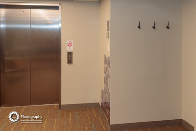 Coat Hooks outside elevator: Lower Level