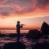 Paul Horn Playing Flute at Ocean Sunset