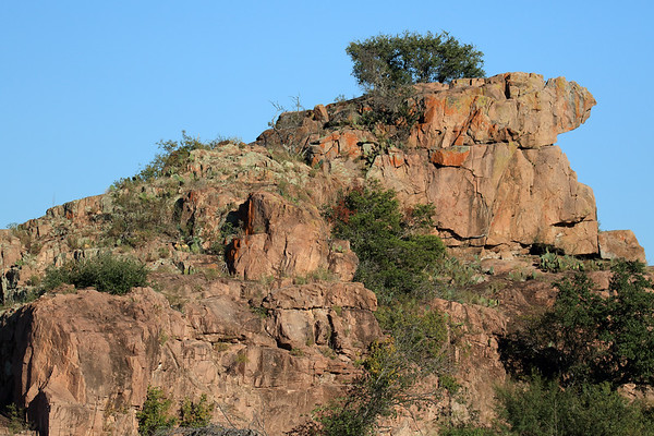 Late afternoon sunlight upon the western slope of Eagles Beak - comprised of intrusive igneous pink granite rock.