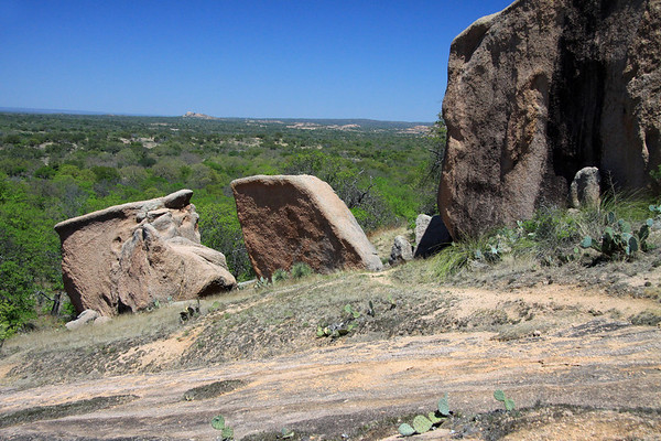 From the granite boulders along the western slope of Little Rock - northeastward to Bullhead Mountain - early spring season - Llano County.
