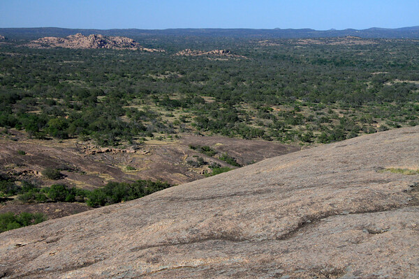 From the northern intrusive igneous granite rock slope of Enchanted Rock - to Watch Mountain (l) - southwestern Llano county.