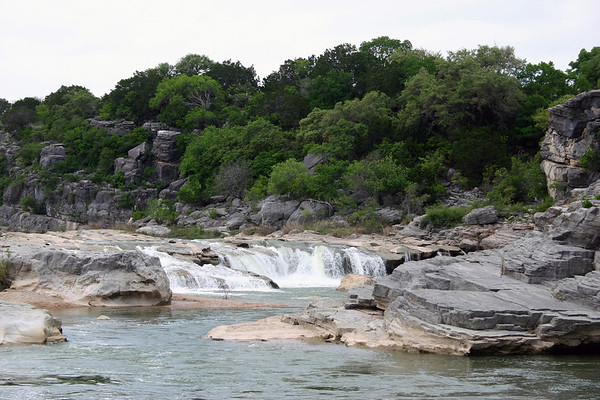 Pedernales Falls - the upper area of this cascading waterfall upon the sedimentary limestone rock - amongst the vegetation of the Edwards Plateau ecoregion.