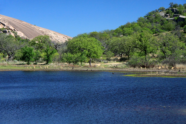 Moss Lake - Enchanted Rock (l) - Little Rock (r) - and the cloudless early Spring season sky above.