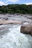 Pedernales Falls and River - sedimentary limestone rock - Edwards Plateau ecoregion vegetation - early spring season.