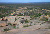 From the exfoliation dome of Enchanted Rock, viewing down the northeastern granite rock slope - to the summits of Freshman Mountain and Buzzard's Roost beyond - with distal the Riley Mountains along the horizon - Llano country - Texas Hill Country.