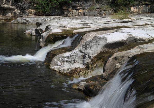 Waterfall along the sedimentary limestone rock of Flat Rock Creek.