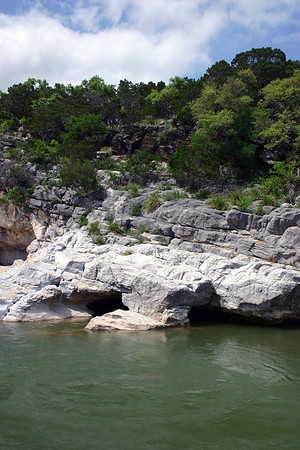 Pool along the upper Pedernales Falls - amongst the sedimentary limestone rock and vegetation of the Edwards Plateau ecoregion - in the Hill Country of central Texas.