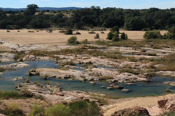 Western bank of the river island from here atop Eagles Beak - along the Llano River - and beyond the sand/pebble bar from the flood of Oct. 16, 2018 - and distal the Riley Mountains.