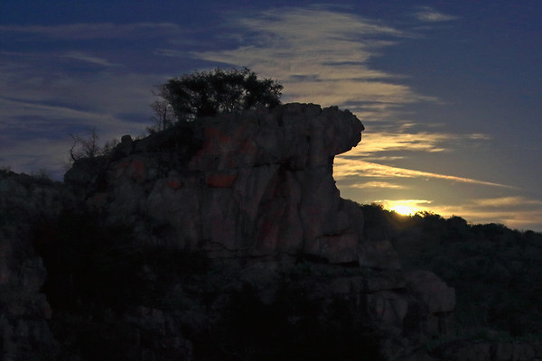Blue Moon - the 2nd full moon occurring within the same month - with foreground the igneous granite rock outcrop of Eagles Beak - eastern Llano county.