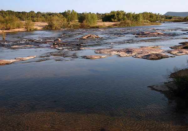 Granite outcrops among the flowing Llano River - during the late summer season - eastern Llano county.