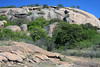 Up the western granite slope of Enchanted Rock - with oak trees scattered throughout.