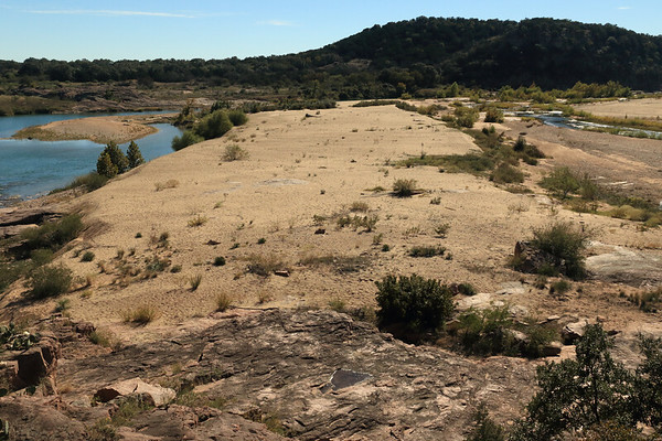 Southward down the river island  - from here upon the granite outcrop of Eagles Beak - with the Llano River along both sides,  amongst the riparian vegetation of Hill Country.