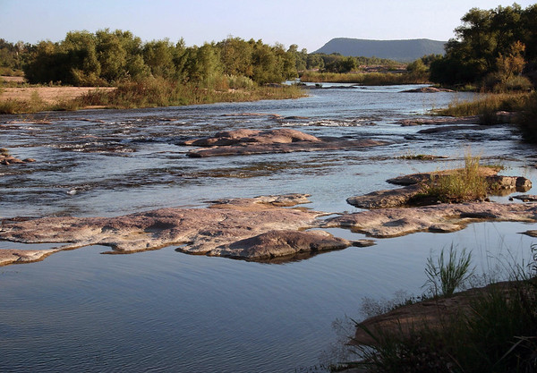 Down the Llano River amongst the granite riverbed - with distal to Packsaddle Mountain.