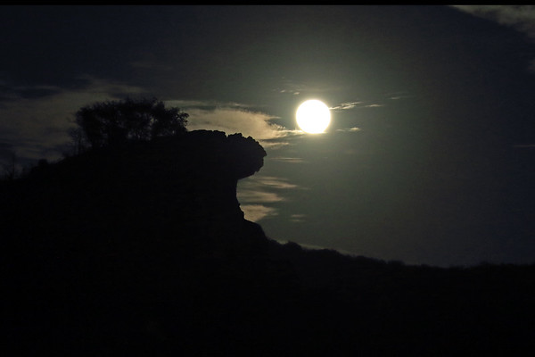 Blue Moon on Halloween - rising above the granite rock outcrop of Eagles Beak - an island in the Llano River - eastern Llano county.