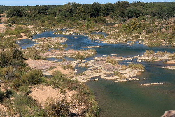 Up the northeastern bank of the river island (l) - amongst the smaller granite islands and riparian vegetation thereupon - from here atop Eagles Beak - with distal the mouth of Tantrough Creek, along the horseshoe shape meander of the Llano River.