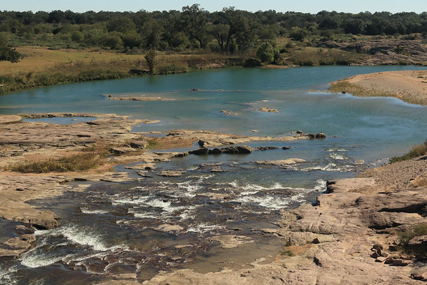 Down the Llano River - from here atop Eagles Beak, upon the river island - among the mid-afternoon sunlight, on Halloween - tonight a Blue Moon.