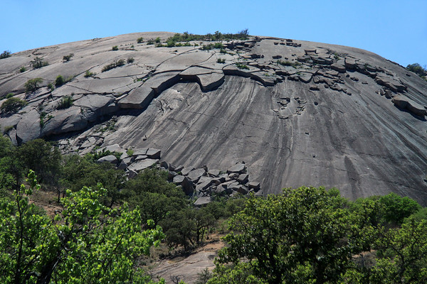 Northern slope of Little Rock, an intrusive igneous granite exfoliation dome.