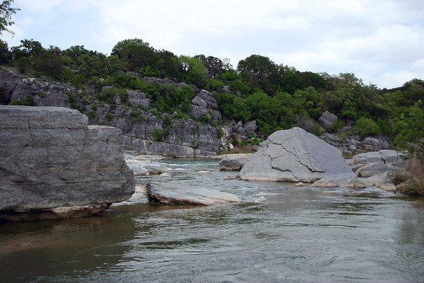 Down the cloud-shadowed Pedernales River - amongst the sedimentary limestone rock and vegetation of Texas Hill Country - Pedernales Falls State Park - eastern Blanco county.