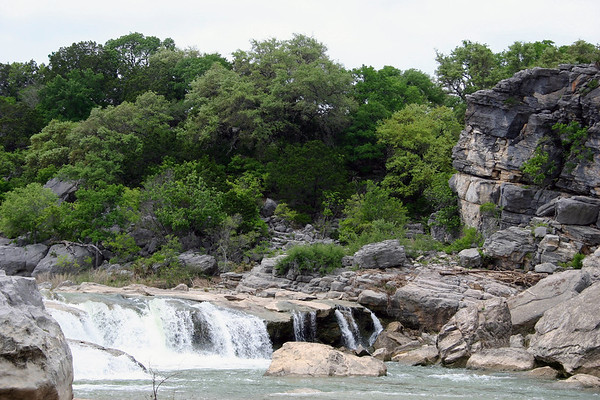 Pedernales Falls - the upper area of the cascading water among the sedimentary limestone rock, and early spring season vegetation of the Edwards Plateau ecoregion.