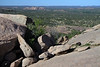 Granite boulders along northern slope of Enchanted Rock - Watch Mountain beyond - southwestern Llano county.
