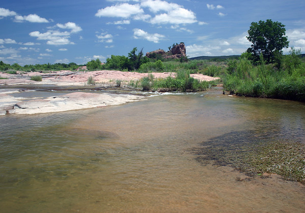 Up the Llano River - to Eagle's Beak, an intrusive igneous pink granite outcrop, upon an elongated river island, measuring about .6 mi (1km) long and 400 ft (122 m) at its widest - a site/place I nicknamed Isla Tres Rocas - as seen from here along the southwestern bank of the island (r) - eastern Llano county - during the late spring season of 2014.