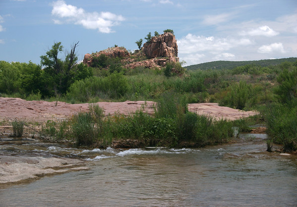 Island along the Llano River - with the 50 ft outcrop of Eagle's Beak thereupon.