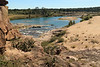Eagles Beak - a 50 ft (15 m) pink granite rock outcrop protruding from upon an elongated river island, measuring about .6 mi (1 km) long and 400 ft (122 m) at its widest - here upon the Llano River - viewing southward beyond the whitewater rapids during the mid-fall season, amongst the mid-afternoon sunlight on Oct. 31, 2020 (with tonight a BLUE MOON) - located in the eastern area of Llano county.
