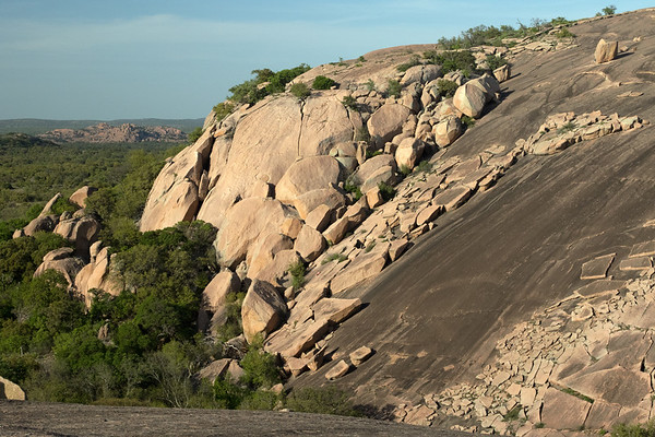 """""""Exfoliation Domes"""" of Little Rock and Enchanted Rock - this geological process occurs when these molten bodies, or plutons, solidified deep underground - subsequent faulting and weather erosion has unroofed the granite plutons of this volcanic rock from the Precambrian rock (prior to about 540 million years ago), geologist actually date this rock to around 1 billion years old, making it some of the oldest volcanic rock in the USA, as a result the solid rock acquired fine cracks through pressure-release jointing, time weathering has opened up the joints further and loosened these slabs, forming concentric layers of rounded boulder masses called """"exfoliation domes""""."""