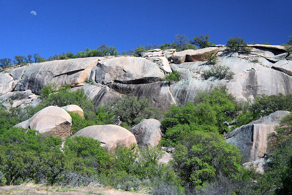 1st Quarter Moon (waxing) - above the exfoliating granite dome of Enchanted Rock - during the early Spring season and  under the mid-afternoon sunlight.