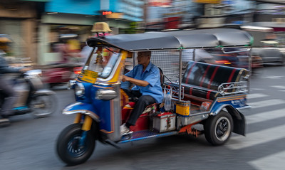 Tuk Tuk Taxi on the Move in Bangkok