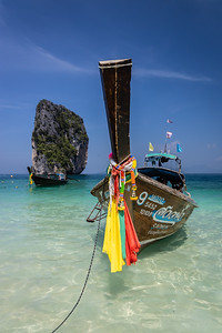 Longtail boats at rest near Krabi.