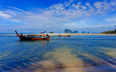 Fishing Boat, Tourist Boat, Long Tail Boat Heading out from Andaman Sea Estuary in Southern Thailand
