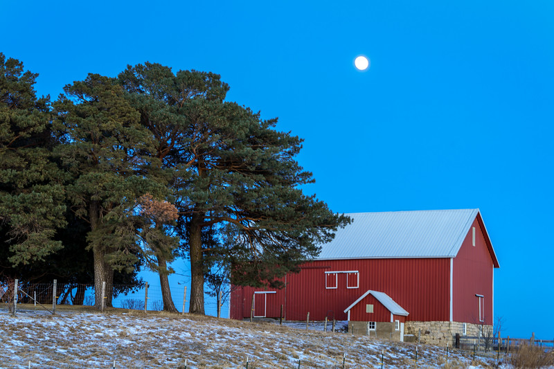 Moon over barn