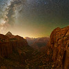 Night With Milkyway and Zion Canyon - Zion NP, Utah<br /> *<br /> Nikon D5, 24mm, f/2.0, 30 sec, ISO 10,000<br /> *<br /> I'm completely surprised this image worked out based on the struggles I had when I first started shooting this night.  This image was taken at the Canyon Overlook from where you can see Zion Canyon.  I had never trekked the 1/2mile little trail until I did in the middle of the night.  I'd never stood at the overlook, the edge of the 500' drop until that night.  Funny enough, I wasn't the only person out there in the middle of the night.  Interestingly enough, I wasn't the only person out there in the middle of the night.  A group was walking around, headlamps glowing, carrying on thinking their sound wasn't echoing throughout the canyon.  Despite all that, setting up and getting to shoot, I immediately realized, I was probably over my head on this.<br /> *<br /> The problem was I was completely unprepared for dealing with the very bright moon and the Milkyway not being positioned well for a good composition.  I had to rethink how I was going to collect the light to make a usable image.  You see the challenge with these situations is everything happens slower because exposures take forever—upwards of 30 seconds.  And, things don't necessarily come together when you combine all that imagery with your computer when you're back at home.  Not only that, shooting so everything was relatively in focus is a super challenge when you're using a large lens aperture to let in as much light as possible.<br /> *<br /> Difficult as it was, this image showed it worked out.<br /> *<br /> This particular image is made from 28 individual image captures taken in two rows of seven positions.  The bottom row had three images shot at each of the seven positions from left to right.  The top row, the sky was only a single image take at the seven positions from left to right.  In post processing, I added another, darker layer, by underexposing the upper layer.  All told, 