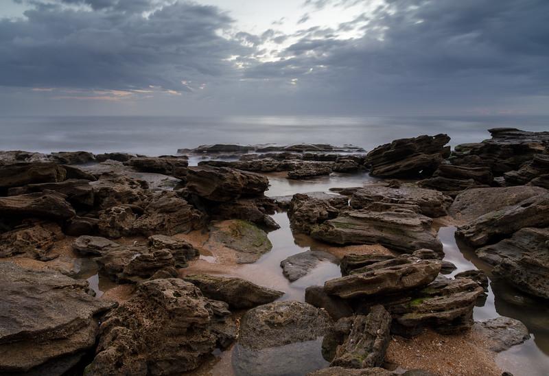 Still Waters on Restless Shore