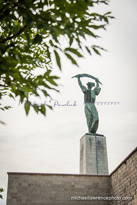 The Liberty Statue. The Szabadság Szobor or Statue of Liberty in Budapest, Hungary, was first erected in 1947 in remembrance of the Soviet liberation of Hungary from Nazi forces during World War II. Its location upon Gellért Hill makes it a prominent feature of Budapest's cityscape.