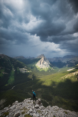 "<i>An incoming storm beyond Anthozoan Mountain during the descent of Bulwark Peak<br>  Banff National Park,<br> <font size=""1"">Alberta, Canada</font></i>"