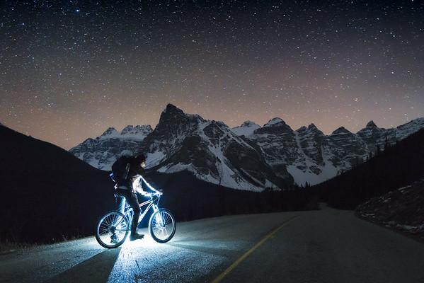 """<i>The night time bike ride into Moraine Lake during the off season,<br>  Banff National Park,<br> <font size=""""1"""">Alberta, Canada</font></i>"""