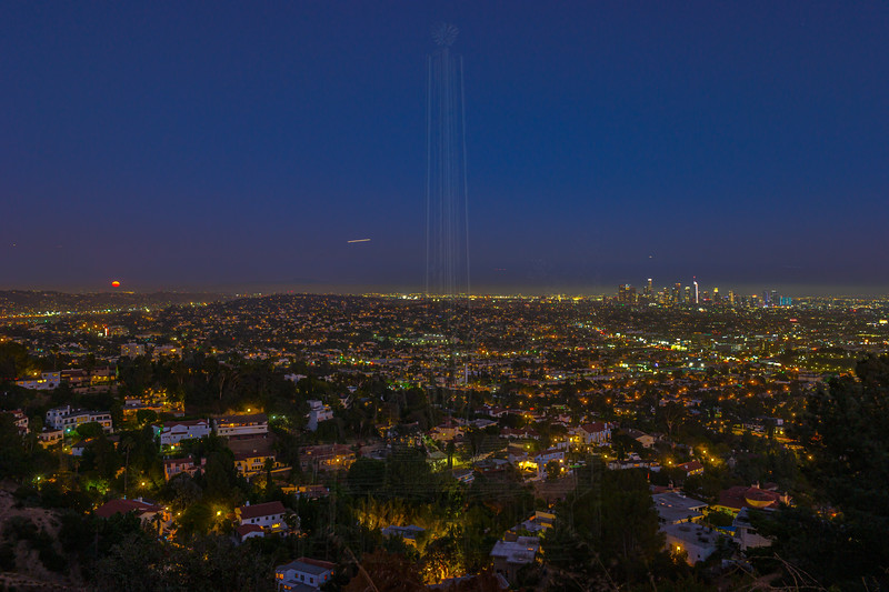 The Moon rises east of Downtown Los Angeles.