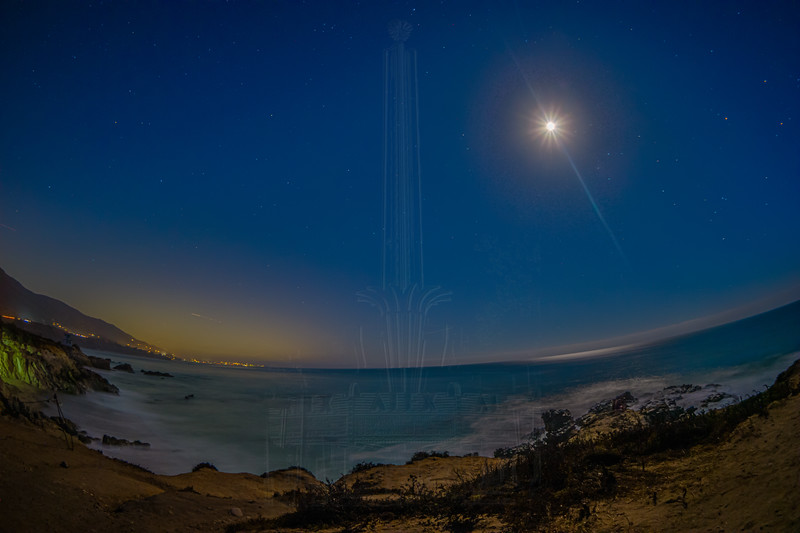 Looking towards Los Angeles on a moonlit night at Leo Carillio State Beach.
