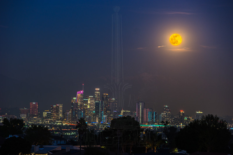 Close shot of the Moon and downtown LA.